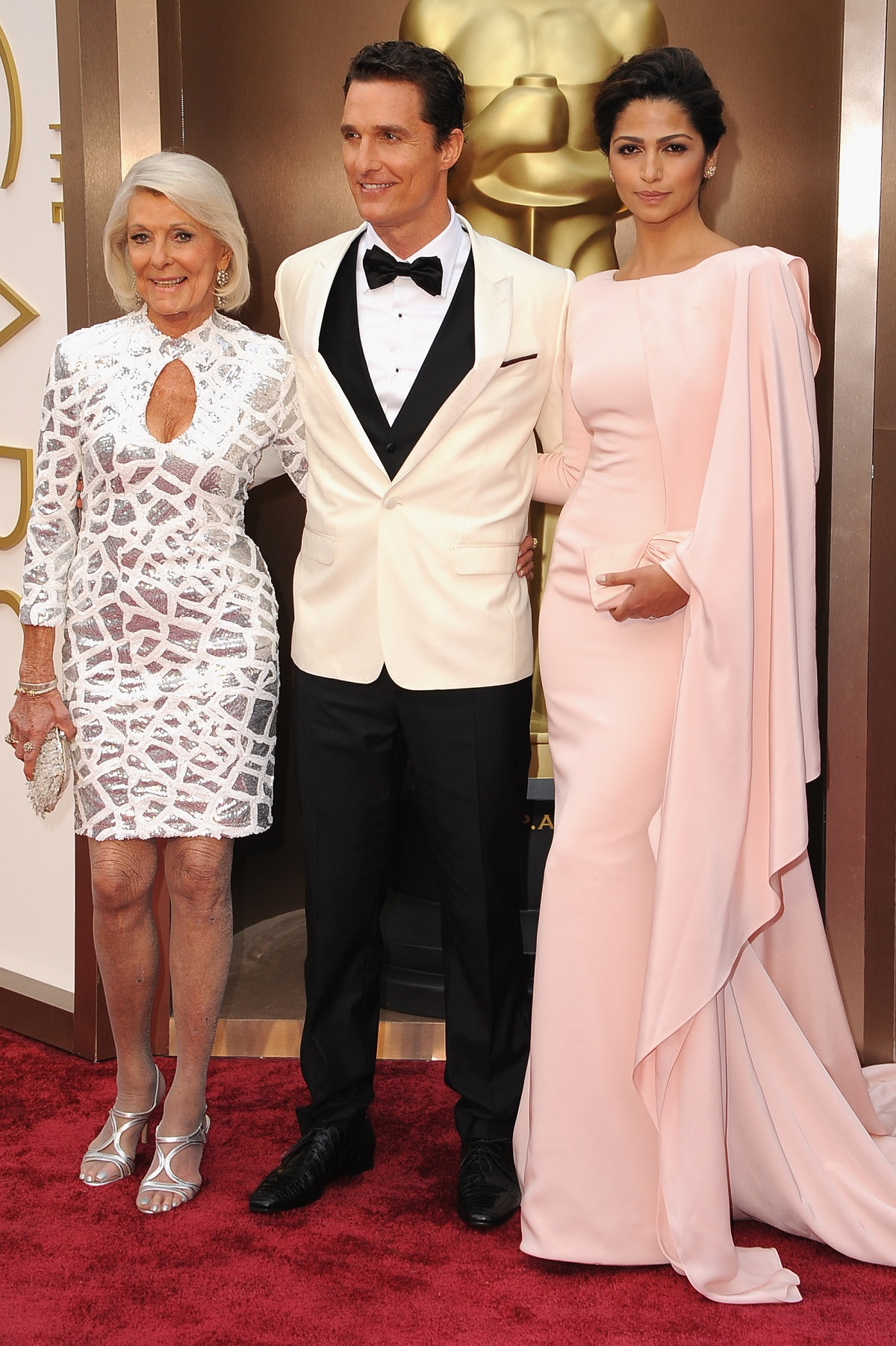 "Matthew McConaughey at the 2014 Oscars on the red carpet with his mom, Mary ""Kay"" McConaughey, and Camila Alves"