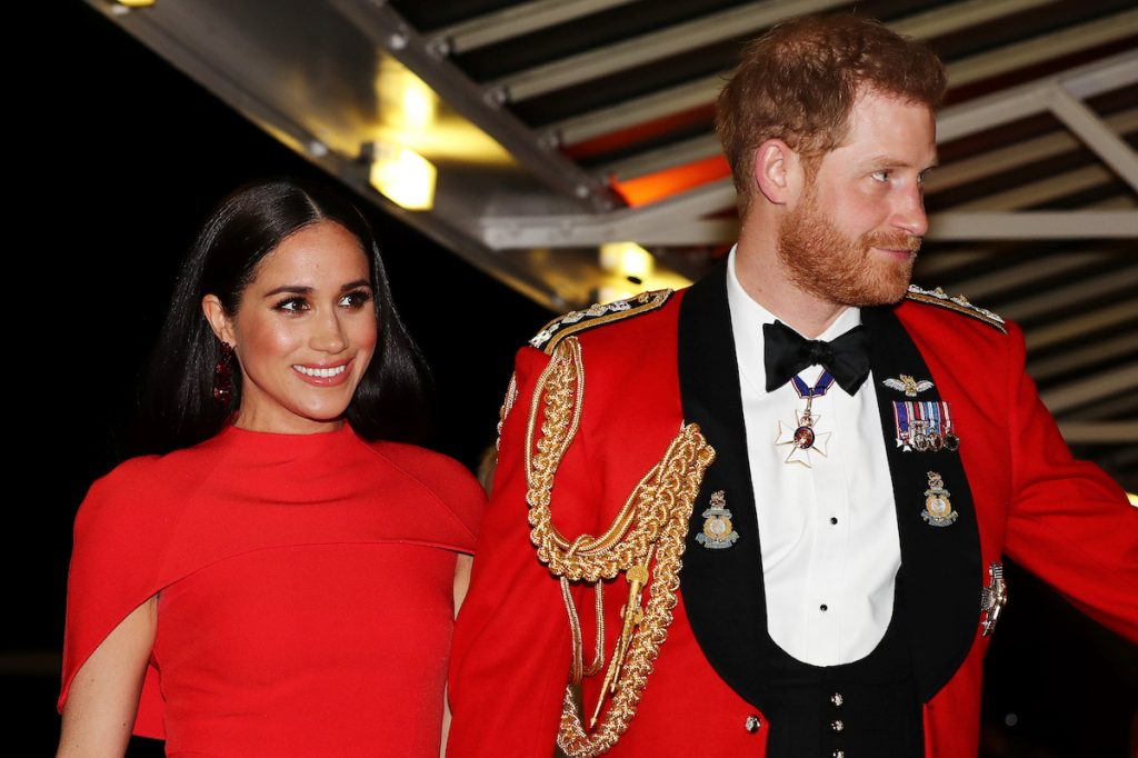 Prince Harry, Duke of Sussex and Meghan, Duchess of Sussex arrive to attend the Mountbatten Music Festival at Royal Albert Hall wearing matching red outfits