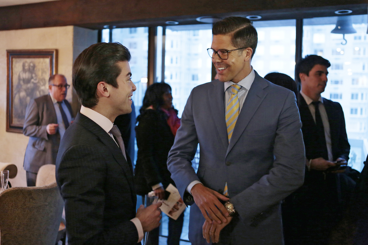 Luis D. Ortiz chats with Fredrik Eklund  at a brokers open