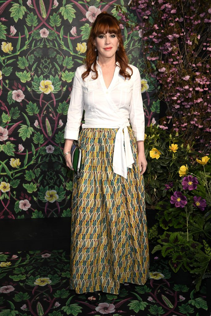 Molly Ringwald dressed in a white blouse and patterned shirt at an event in NYC