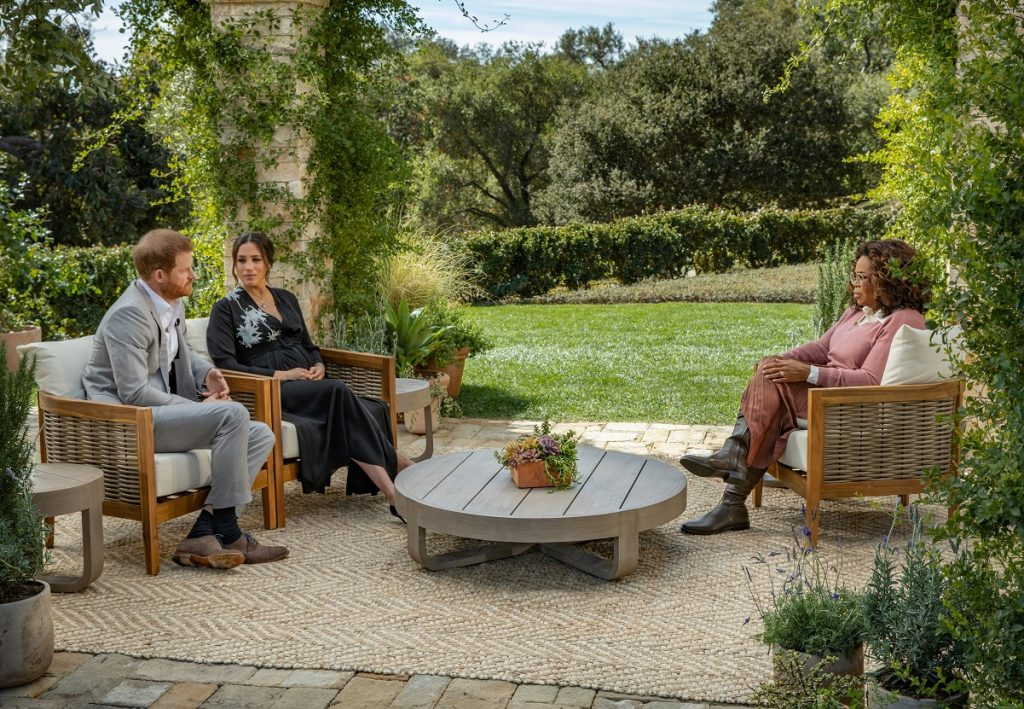 Oprah Winfrey sitting across from Prince Harry and Meghan Markle as she interviews them for CBS special