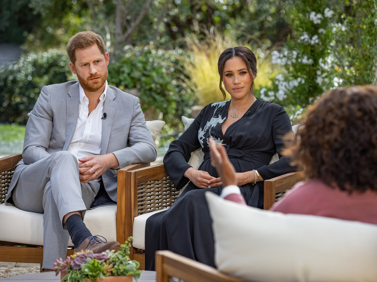 Oprah Winfrey interviewing Prince Harry and Meghan Markle at a property in Santa Barbara