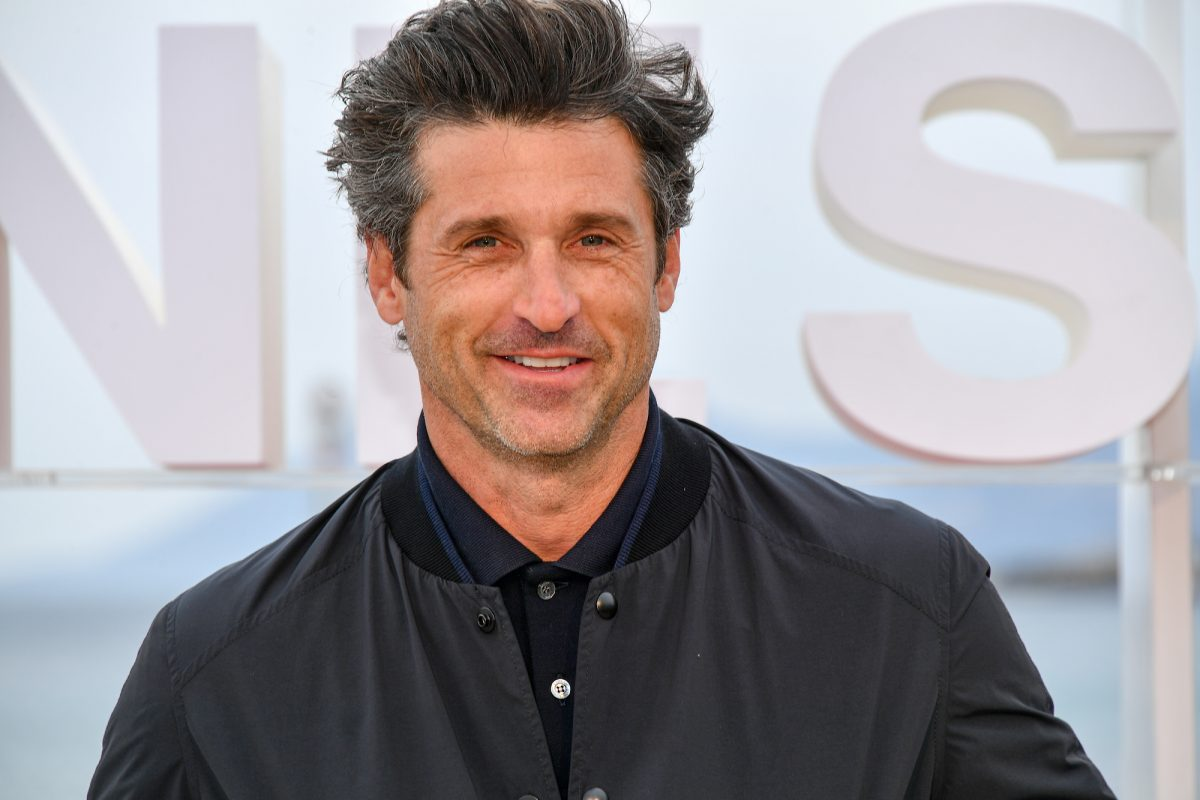 Patrick Dempsey smiling in front of a white background