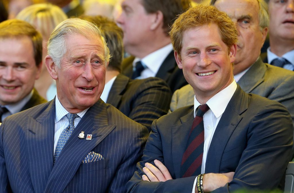 Prince Charles and Prince Harry smiling and laughing in 2014