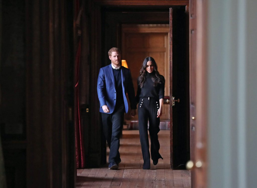 Prince Harry and Meghan Markle in the corridors of the Palace of Holyroodhouse in Edinburgh, Scotland in 2018.