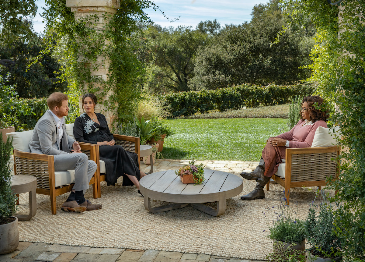 Prince Harry and Meghan Markle sit outside during their interview with Oprah