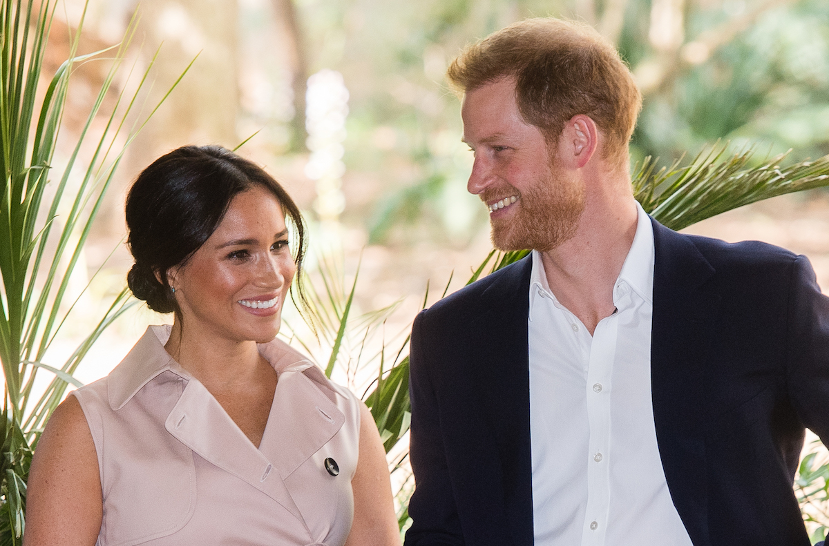 Meghan Markle and Prince Harry smile during a tour of South Africa