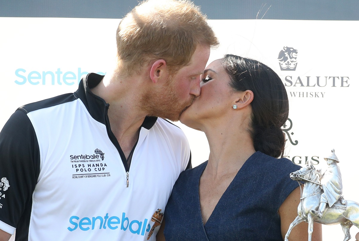 Prince Harry and Meghan Markle kissing after the Sentebale Polo Cup