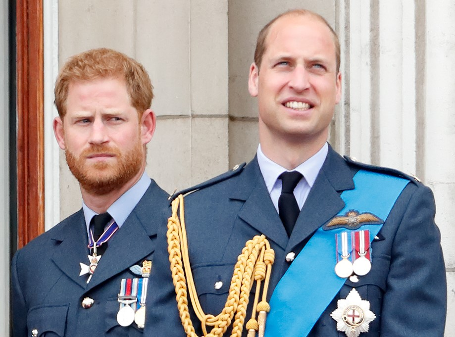 Prince Harry and Prince William standing on the Buckingham Palace balcony during a flypast to mark the centenary of the Royal Air Force