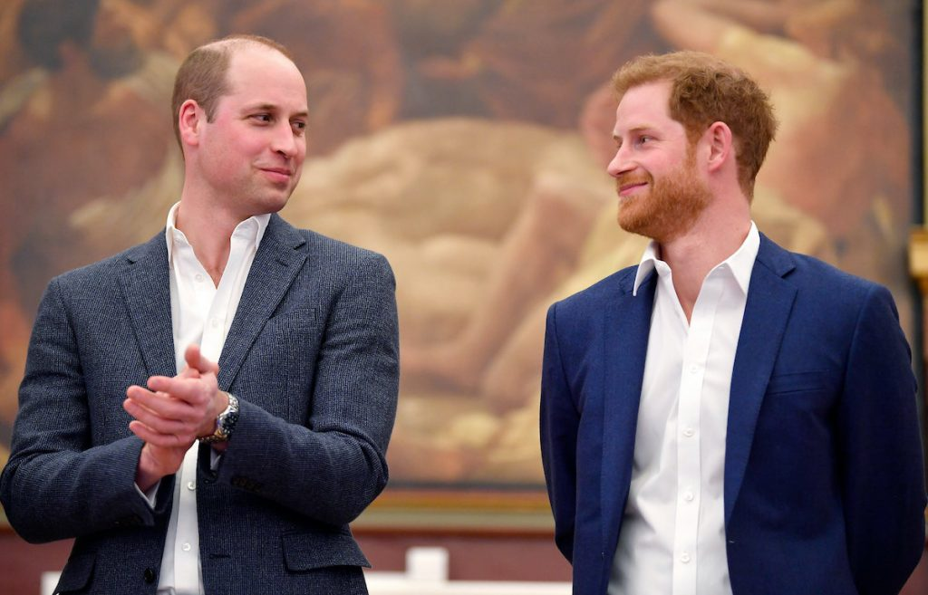 Prince William and Prince Harry share a smile in London in 2018