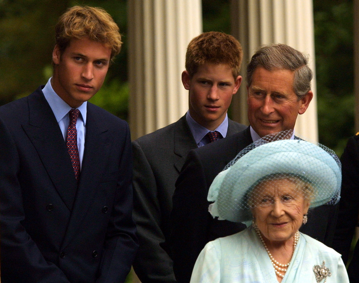 Prince William, Prince Harry, and Prince Charles stand behind the Queen Mother at Prince William's 21st birthday event