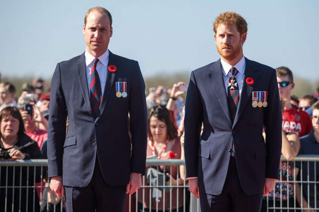 Prince William and Prince Harry standing with their arms at their sides during the centenary commemorative service in Canada