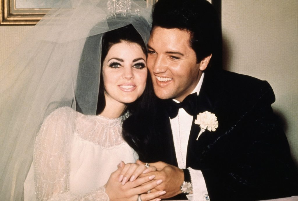 Priscilla and Elvis Presley in wedding garb