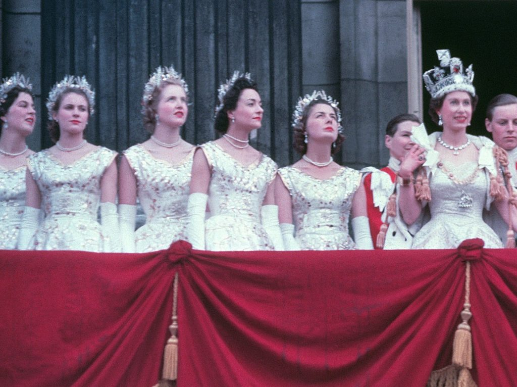 Queen Elizabeth II standing on the balcony of Buckingham Palace with several women by her side following her Coronation