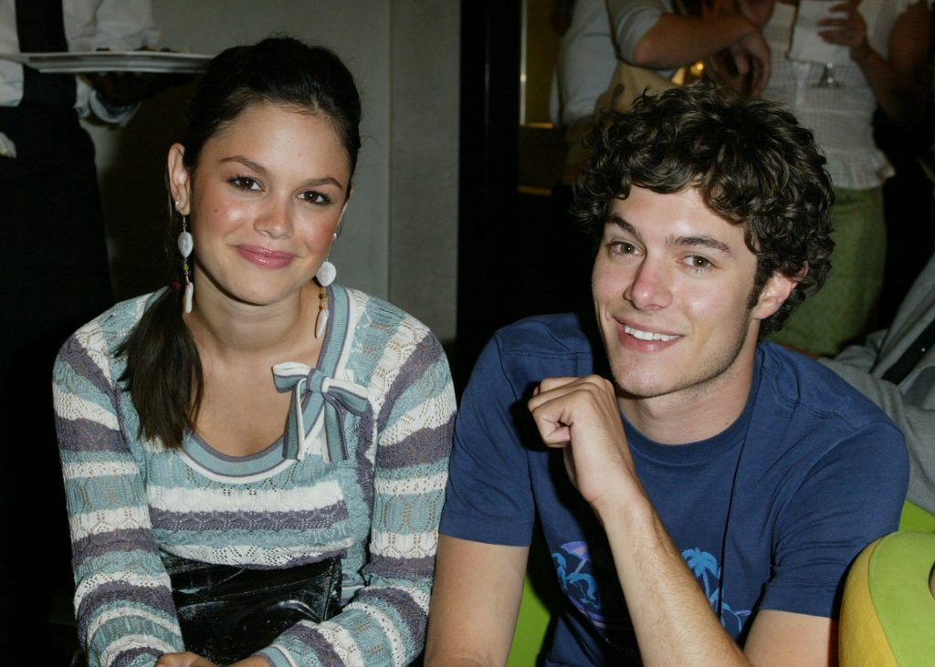 The O.C. cast members Rachel Bilson and Adam Brody smile for the camera at a preview party