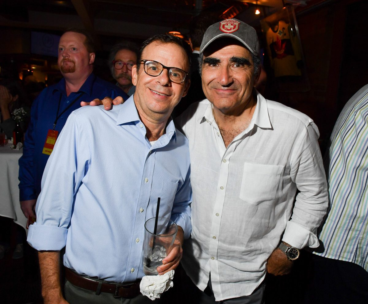 Rick Moranis and Eugene Levy at a party