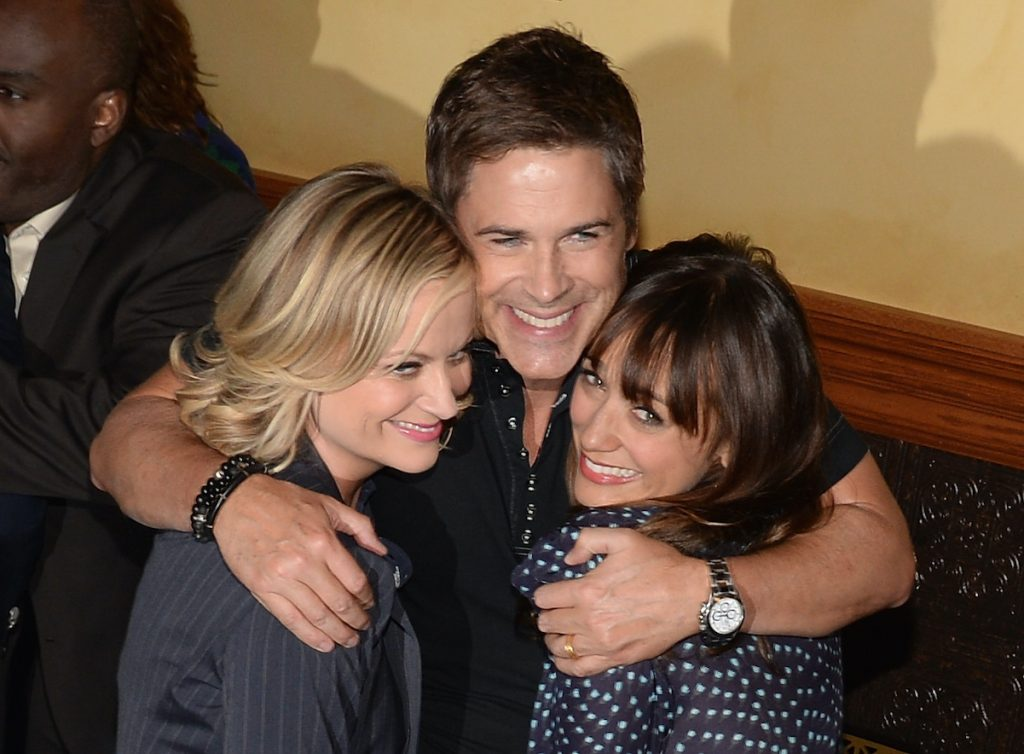 Amy Poehler, Rob Lowe, and Rashida Jones at the show's 100th episode celebration in 2013