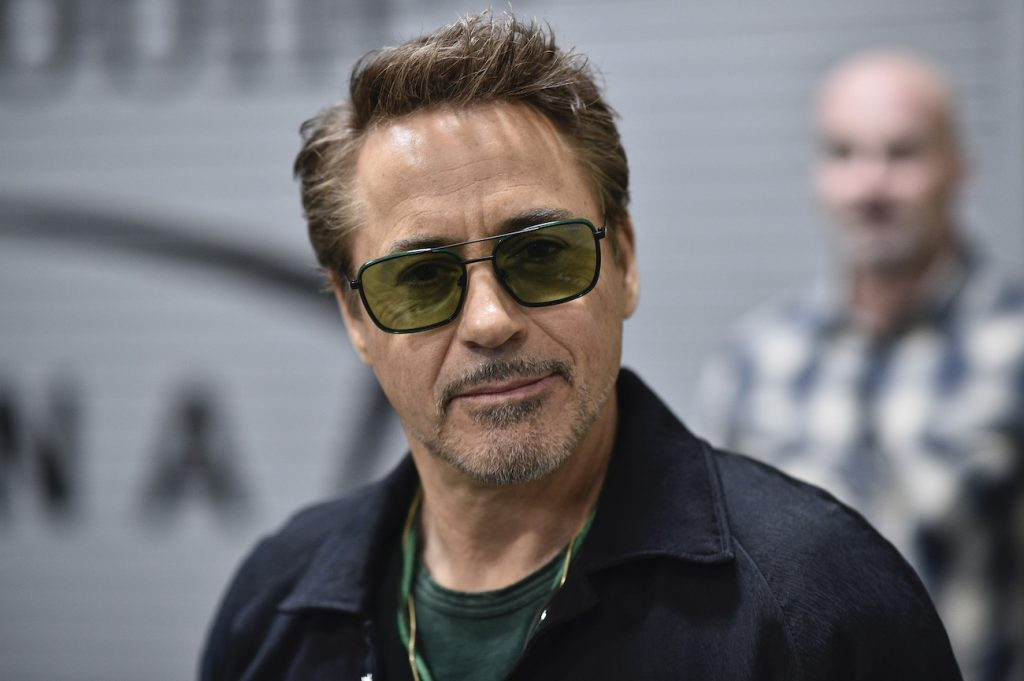 Marvel Star Robert Downey Jr. wearing sunglasses and smiling backstage during the UFC 248 event at T-Mobile Arena