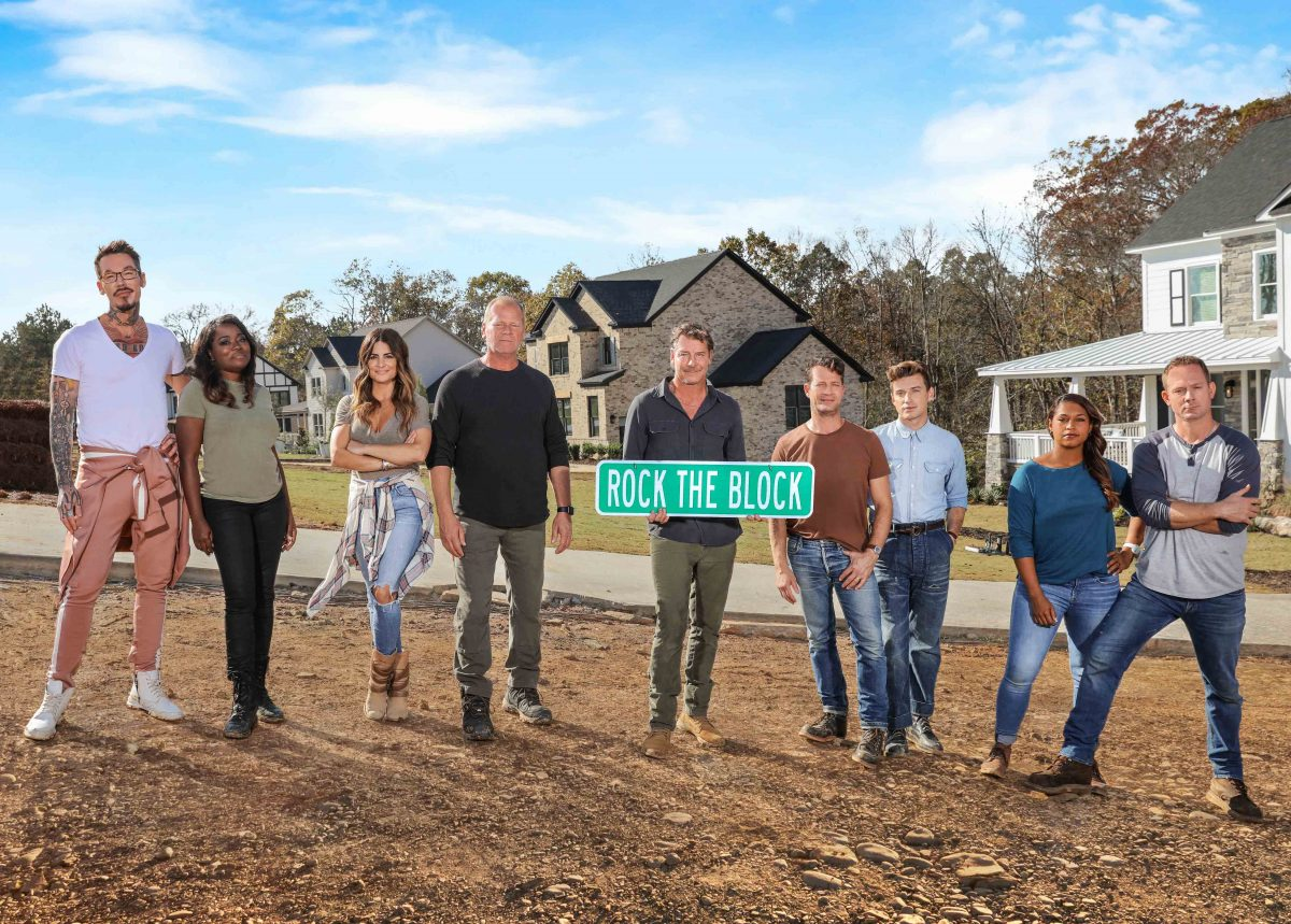 As seen on HGTV's Rock the Block season 2, the cast and host Ty Pennington poses with the houses in the background.