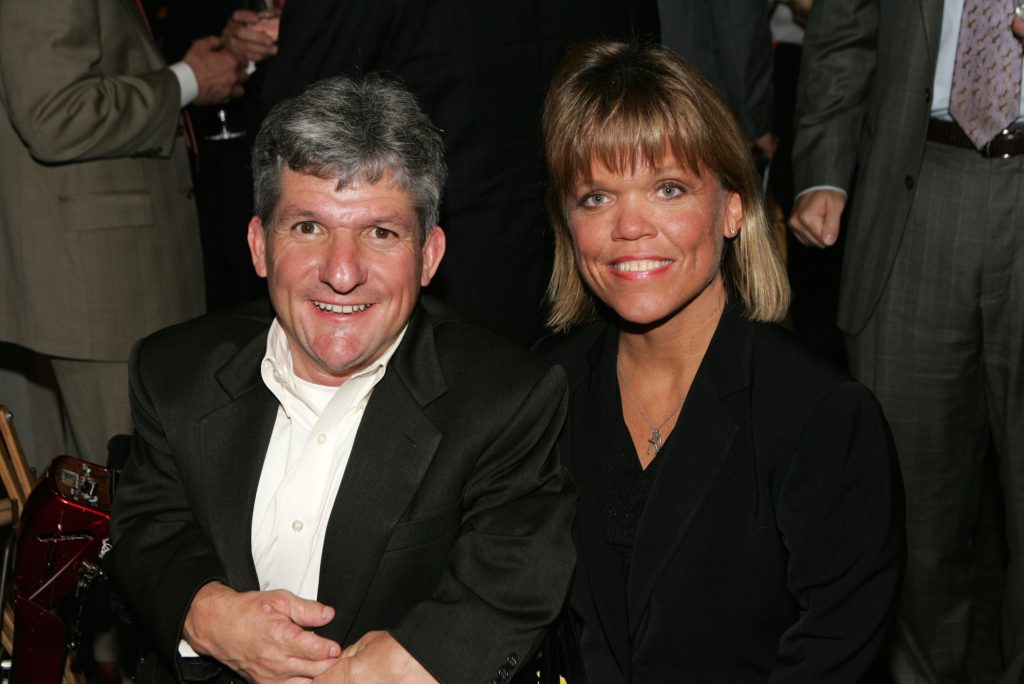 Matt and Amy Roloff, Roloff family members from 'Little People, Big World,' sitting together and smiling at an event