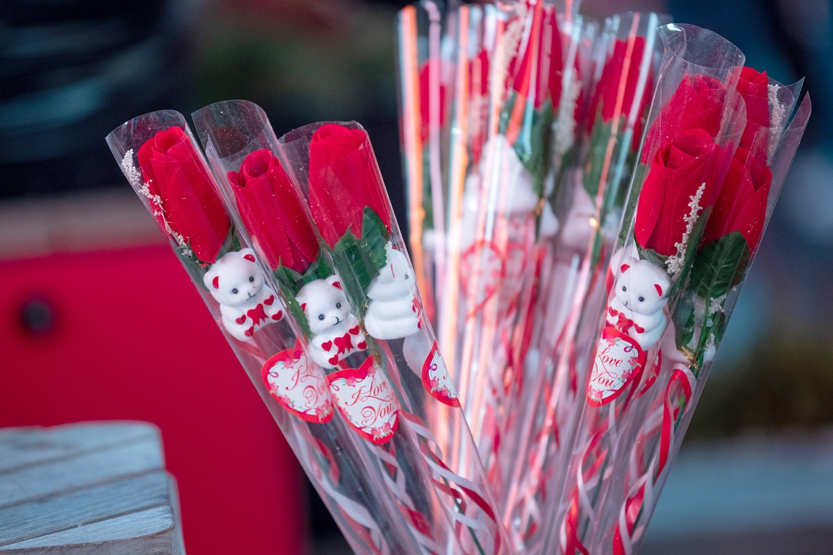 Individual roses in plastic are sold in in Times Square on February 14, 2021 in New York City.