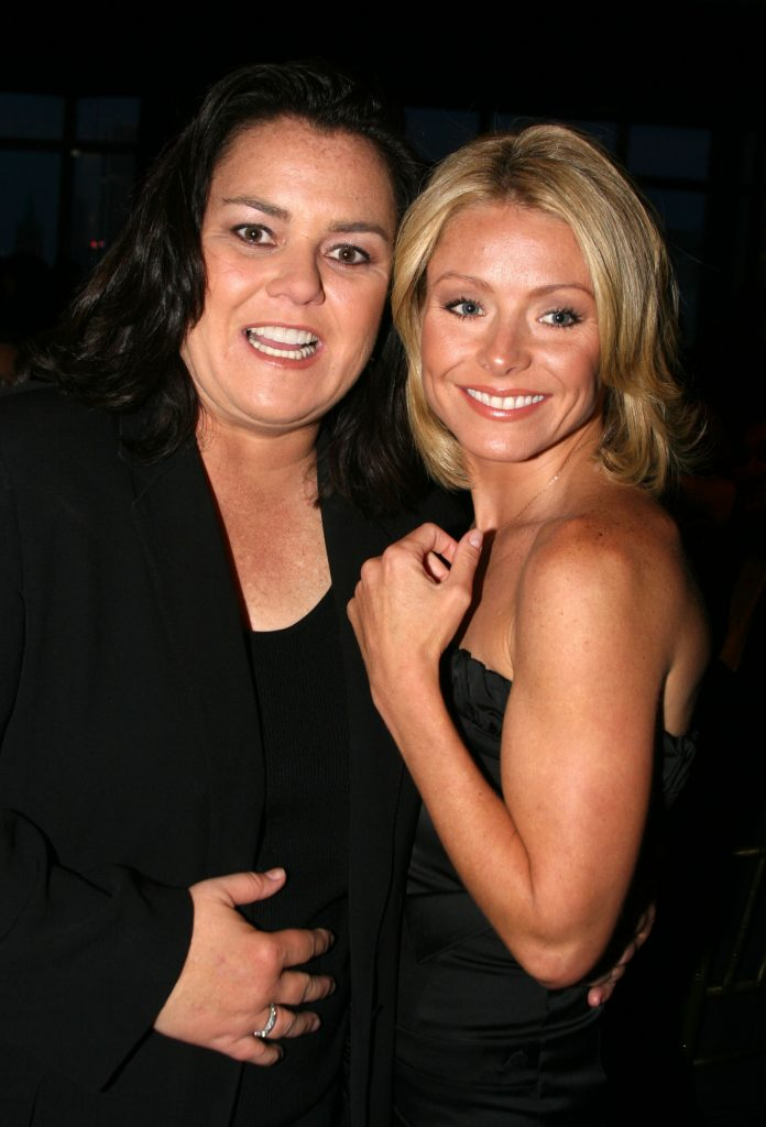 'The View' alum Rosie O'Donnell and 'Live with Kelly and Ryan' star Kelly Ripa stand arm-in-arm, both wearing black, during The Mandarin Oriental Hotel at Gilda's Club Annual Gala
