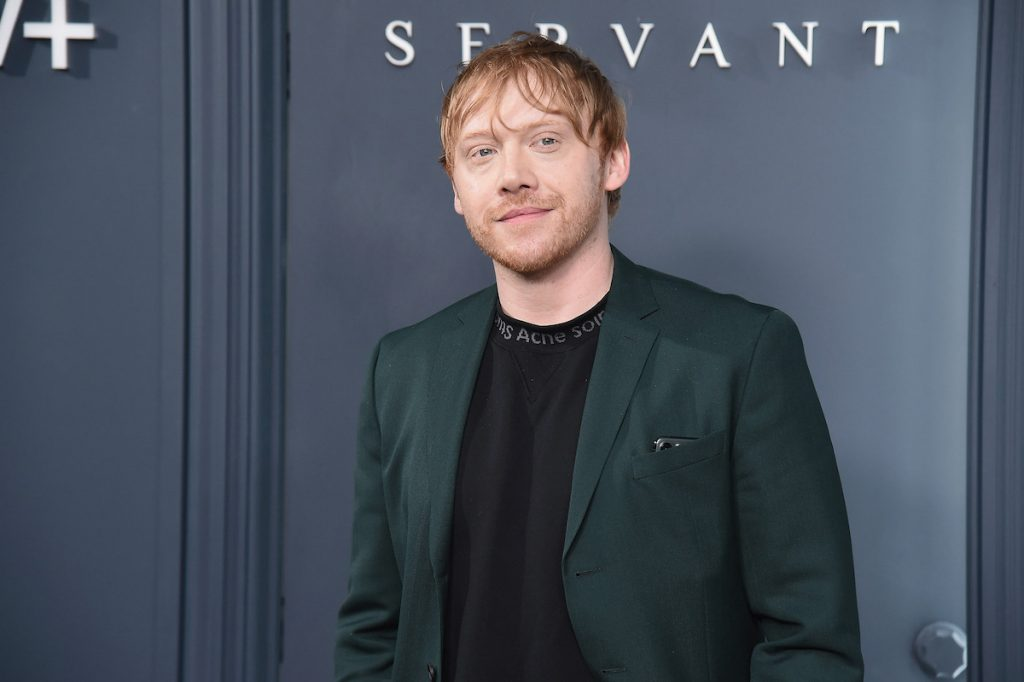 Rupert Grint poses for cameras at the premiere of 'Servant' in 2019