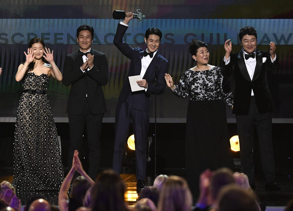 So-dam Park, Sun-kyun Lee, Woo-sik Choi, Jeong-eun Lee, and Kang-ho Song accept Outstanding Performance by a Cast in a Motion