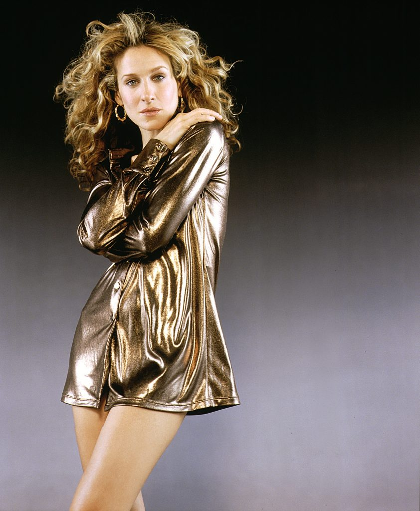 Sarah Jessica Parker poses in a gold dress for a 'Sex and the City' promotional photo
