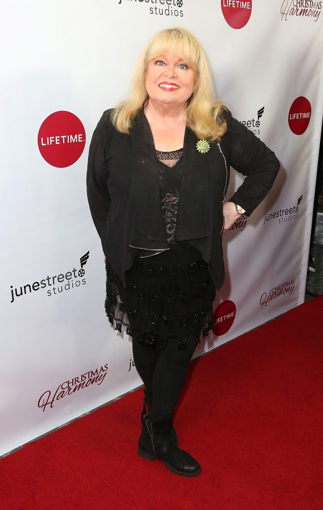Sally Struthers posing with hand on hip at Lifetime's Christmas Harmony premiere