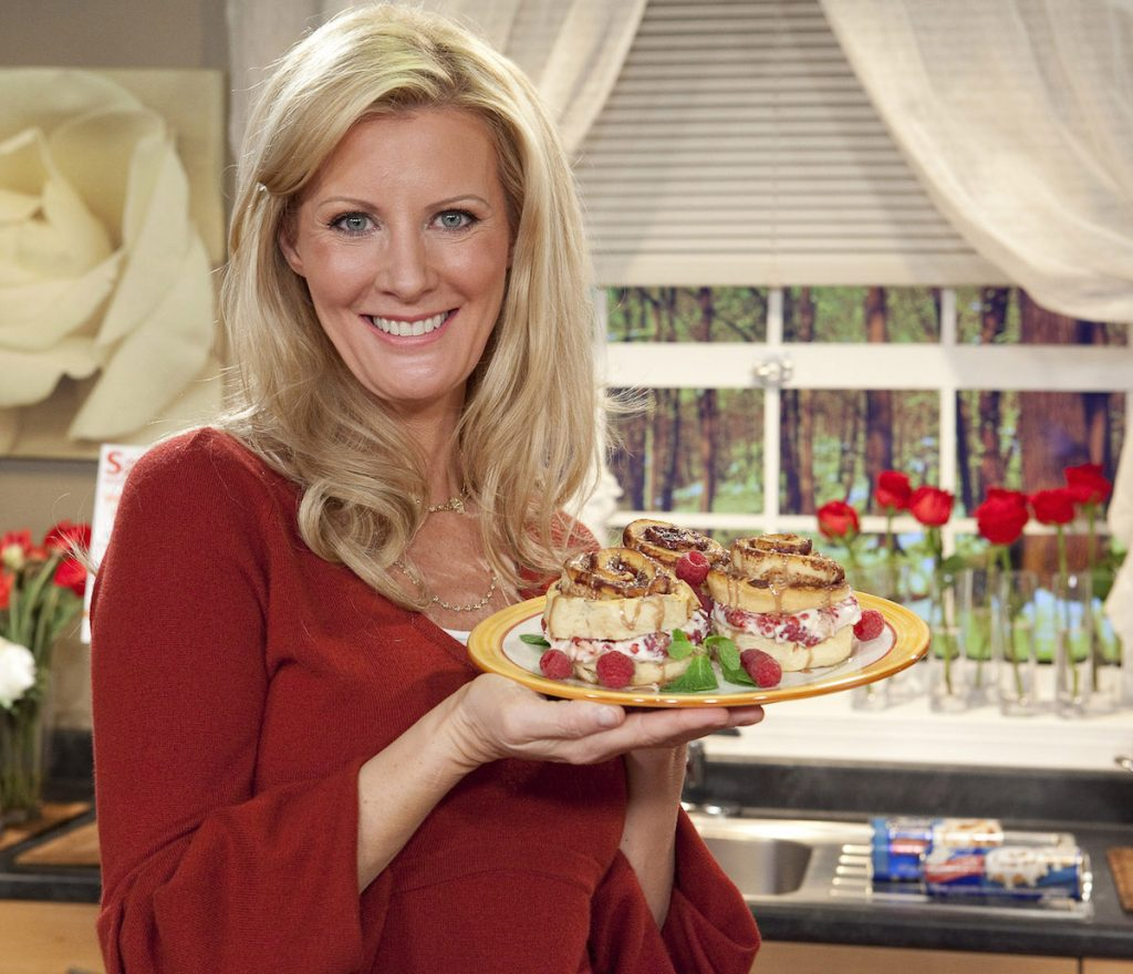 Chef and TV personality Sandra Lee shows off her creation during Sweet Sundays with Sandra Lee and Pillsbury at C and C Studio on February 10, 2010 in New York City.