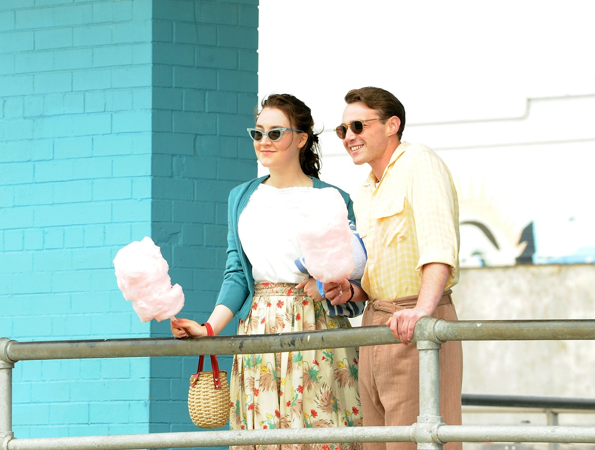Saoirse Ronan and Emory Cohen holding cotton candy at Coney Island on the set of 'Brooklyn'