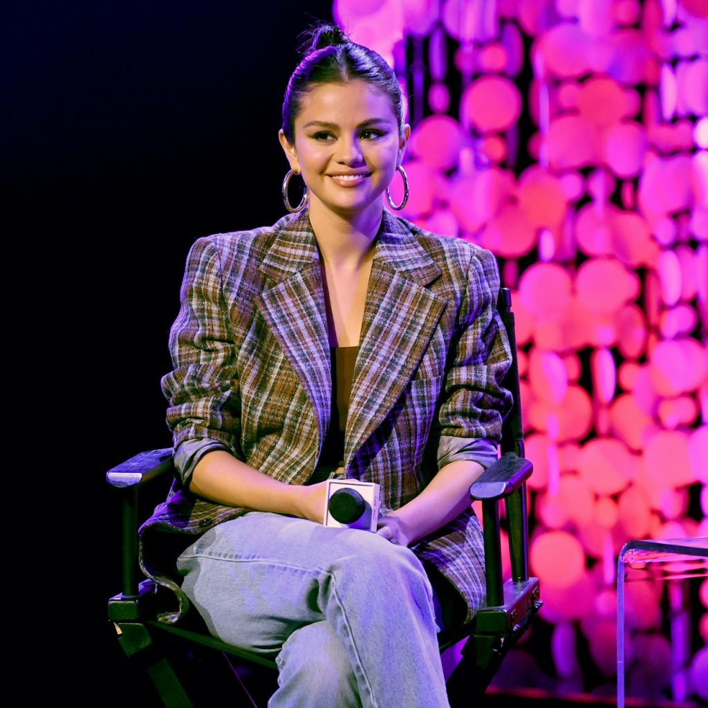 Selena Gomez speaks on stage at the iHeartRadio Album Release Party