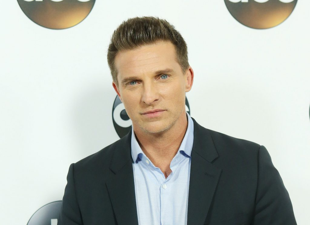 Steve Burton smiling in front of a white background