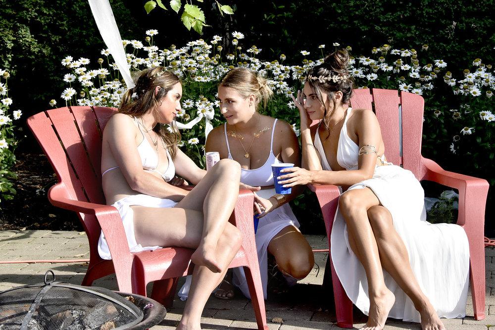 Hannah Berner, Amanda Batula, Paige DeSorbo chat during a party
