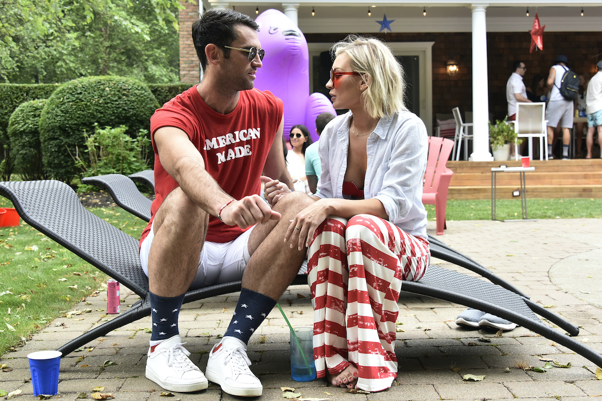 Carl Radke, Lindsay Hubbard from 'Summer House' talk during a party