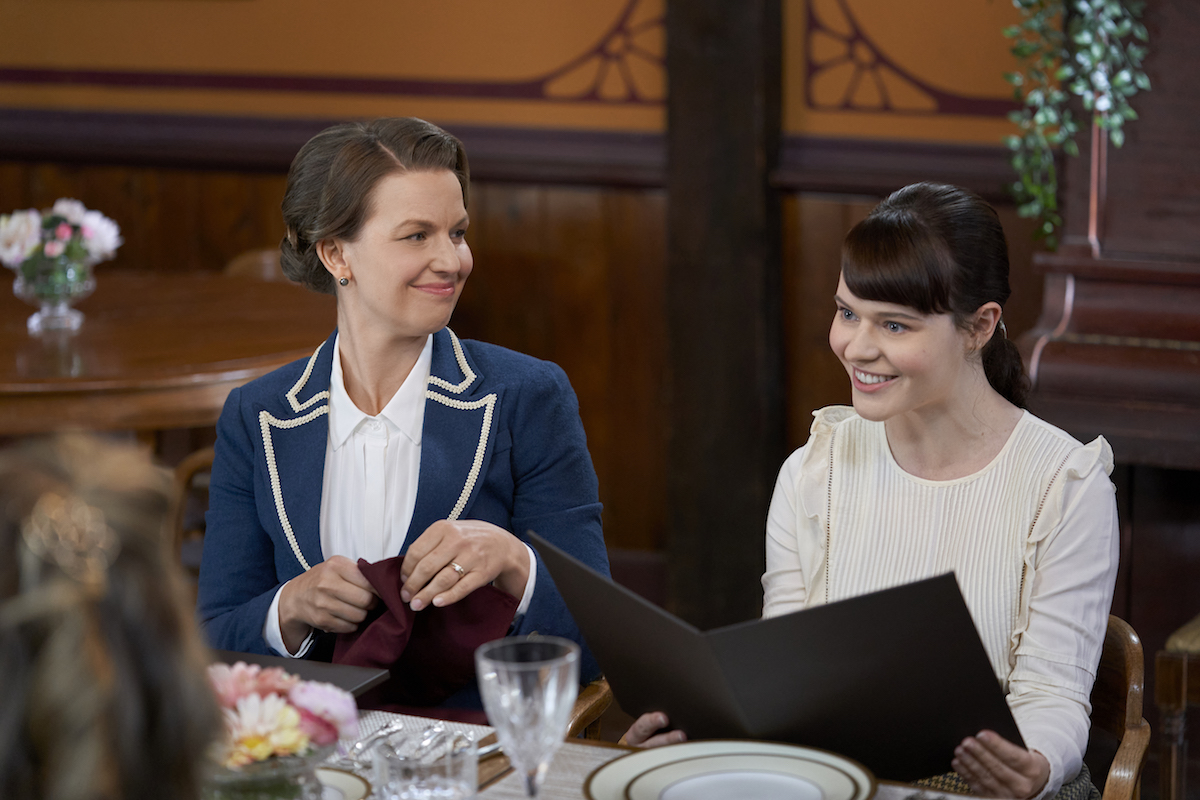Susannah and Rachel sitting at table in When Calls the Heart