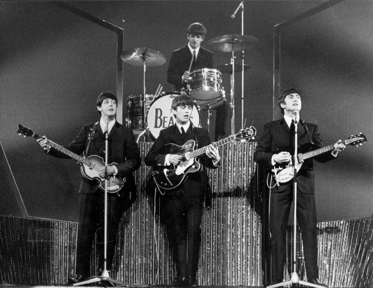 The Beatles on stage at the London Palladium during a performance in front of 2, 000 screaming fans.