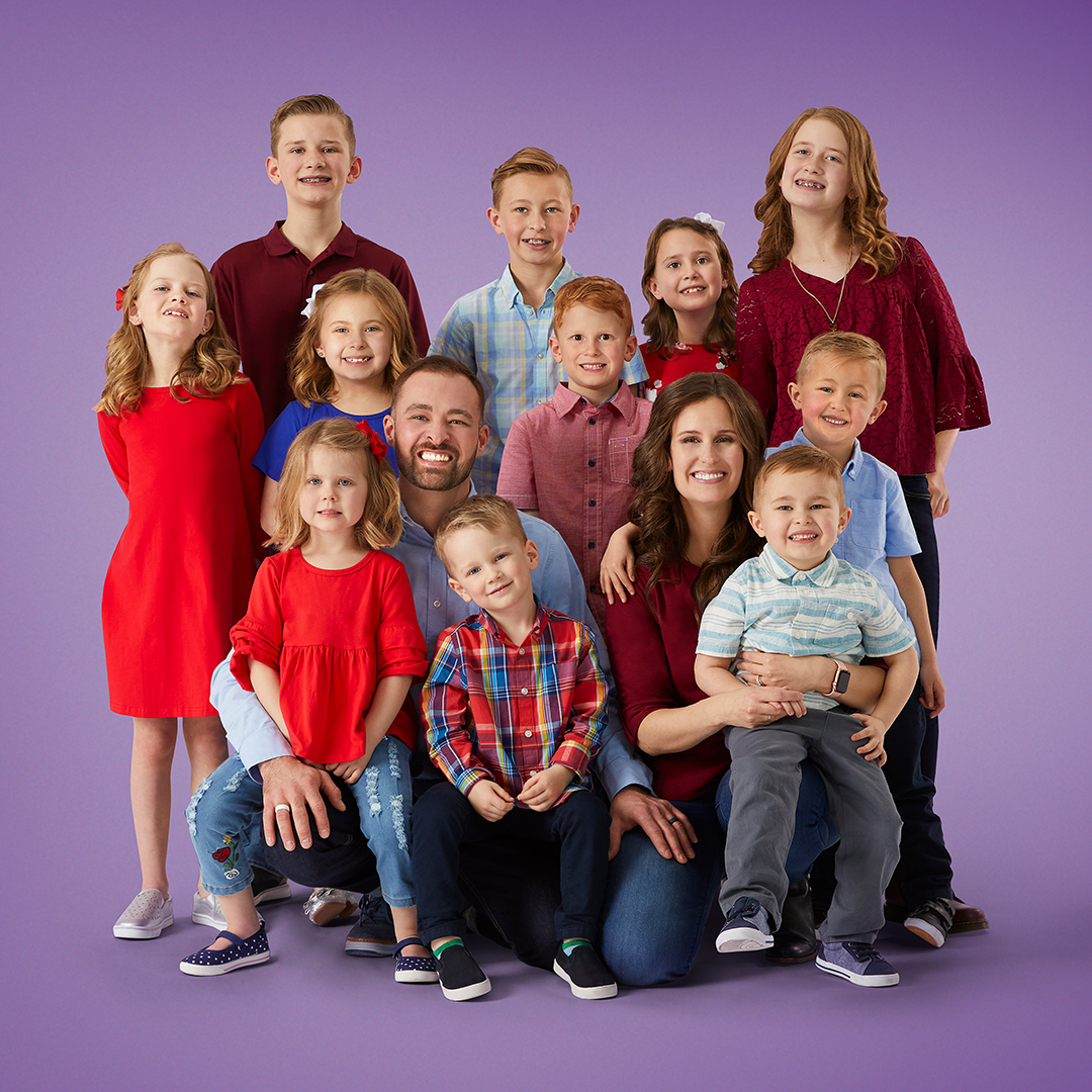 Portrait of the Shemwell family on purple background