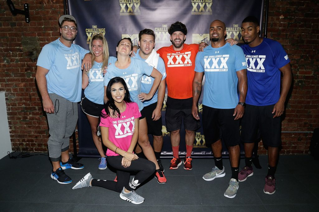 A group of competitors from MTV's 'The Challenge' posing for the camera at 'The Challenge XXX: Ultimate Fan Experience'