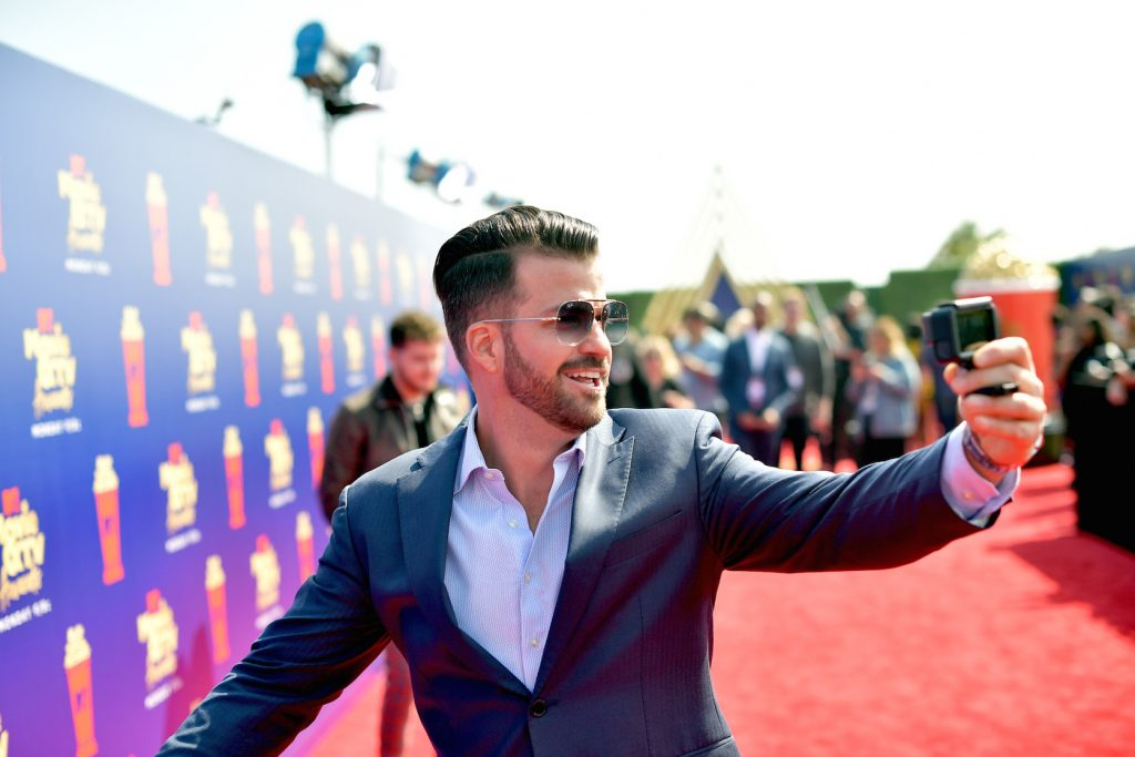 Johnny 'Bananas' Devenanzio from MTV's 'The Challenge' smiling on the red carpet