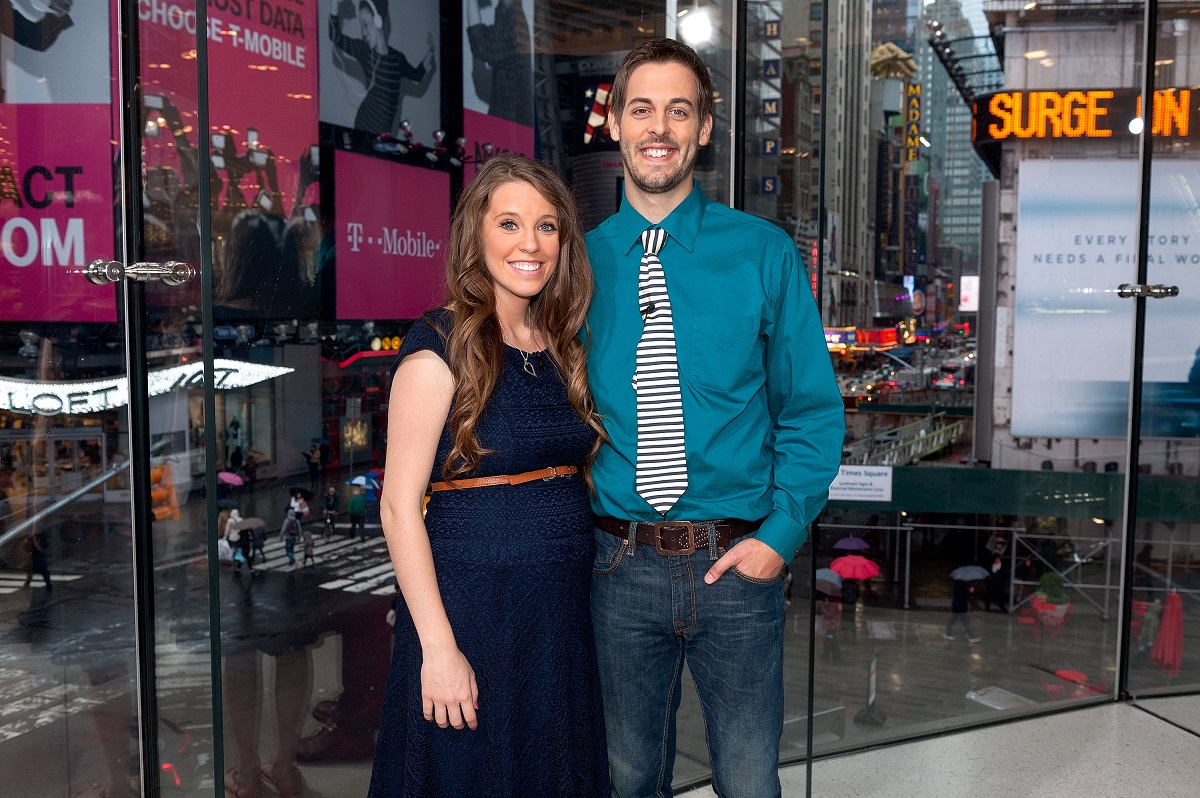 "Jill Duggar Dillard (L) and husband Derick Dillard visit ""Extra"" at their New York studios at H&M in Times Square on October 23, 2014 in New York City."