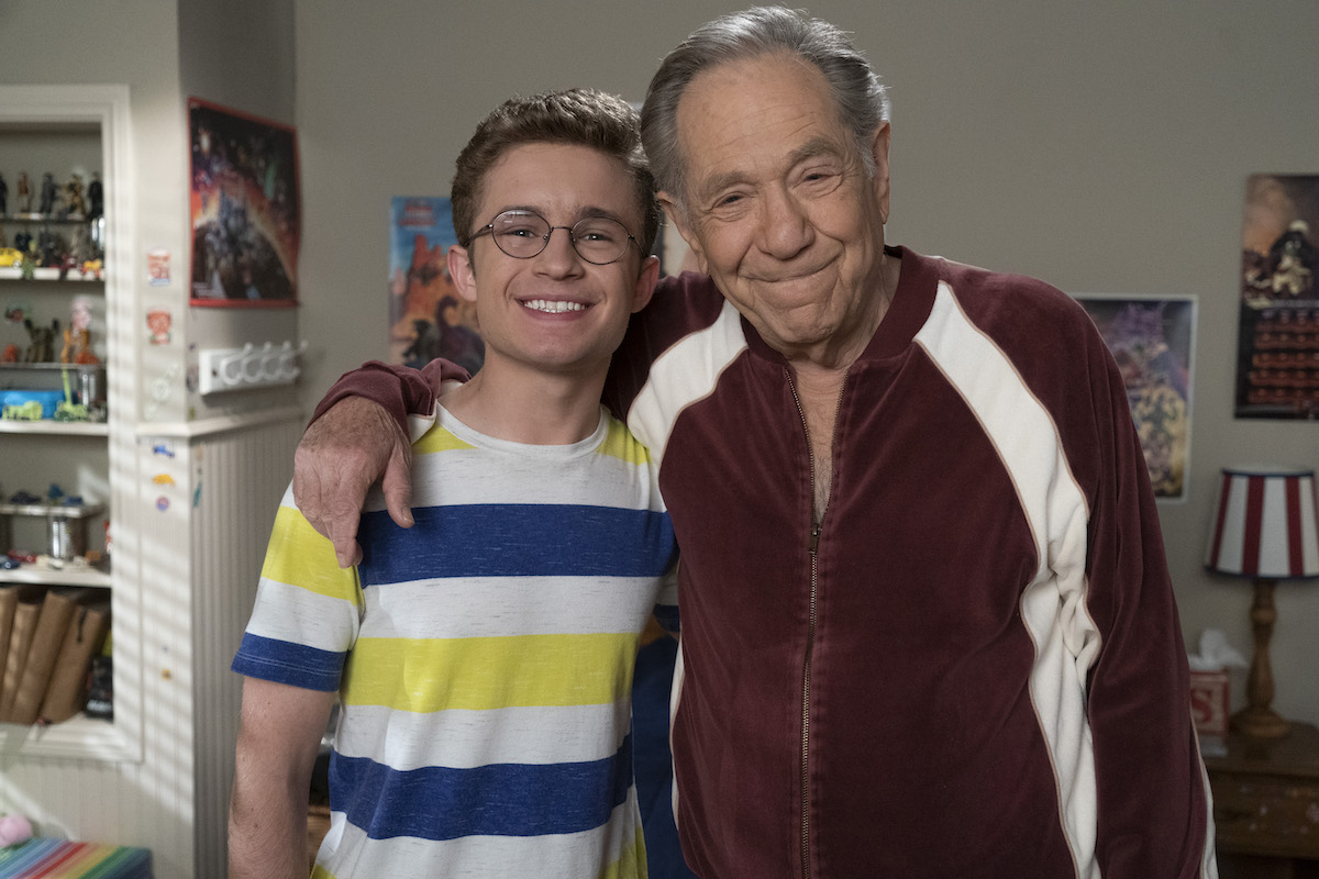 Sean Giambrone and George Segal on the set of The Goldbergs