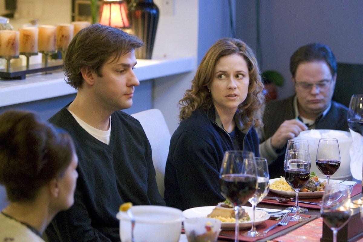 John Krasinski as Jim Halpert, Jenna Fischer as Pam Beesly, Rainn Wilson as Dwight Schrute sit together at a dinner table on 'The Office' Dinner Party