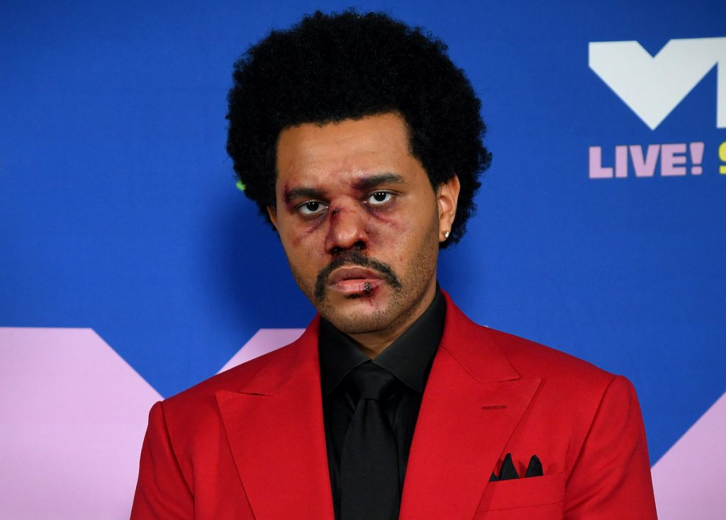 The Weeknd in a red suit and black shirt with fake bruises on his face as he arrives at the 2020 MTV Video Music Awards on August 30, 2020 | Kevin Mazur/MTV VMAs 2020/Getty Images for MTV