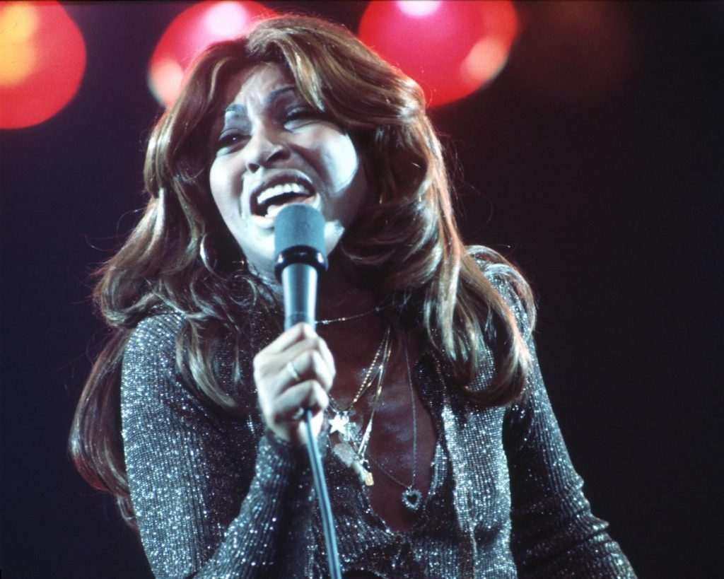 Tina Turner with long brown hair performing in a silver, glittering bodysuit on 'Don Kirshner's Rock Concert' in 1976