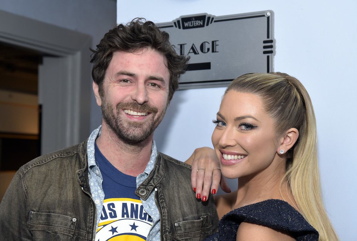 Beau Clark and  Stassi Schroeder pose backstage before a live 2019 show