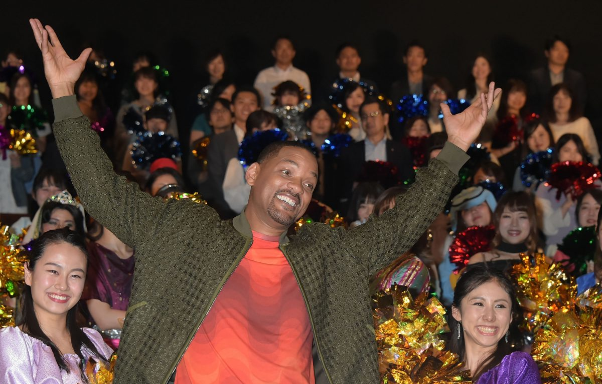 Will Smith raises arms in front of Tokyo fans