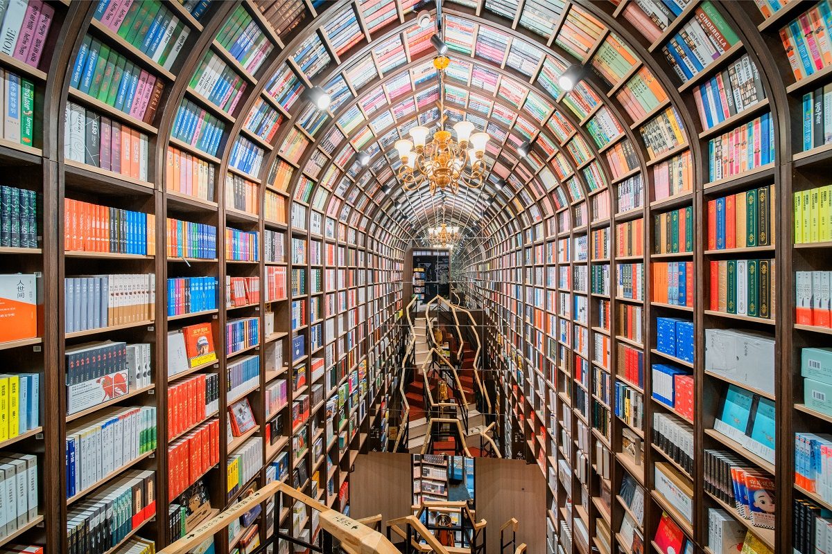 The arched interior of the Zhongshuge bookstore in Beijing in 2020 with colorful shelves of books