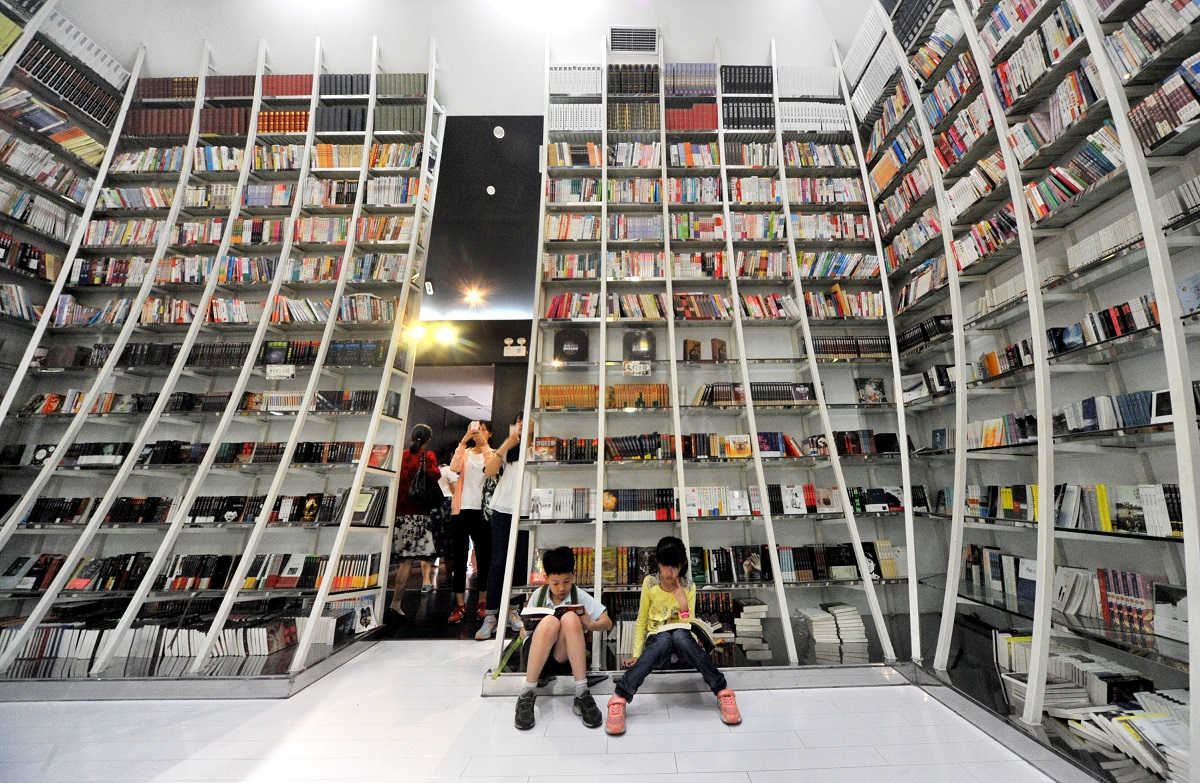 People reading and taking photos at Zhongshuge Bookstore in Shanghai
